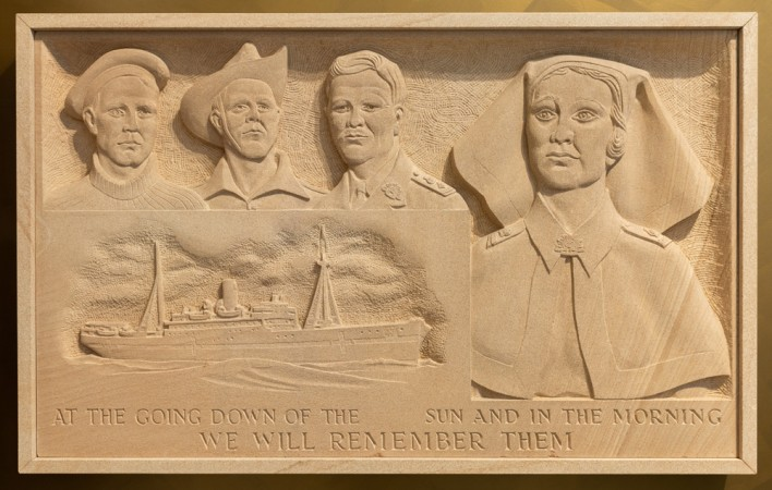 Sandstone plaque of soldiers, boat and nurse