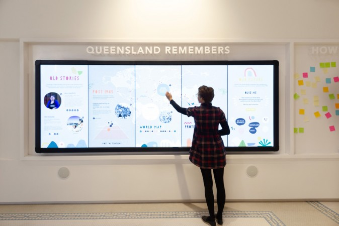 Woman at Queensland Remembers exhibition