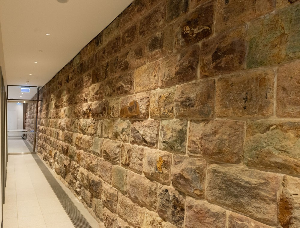 Sandstone wall inside Post World War II gallery