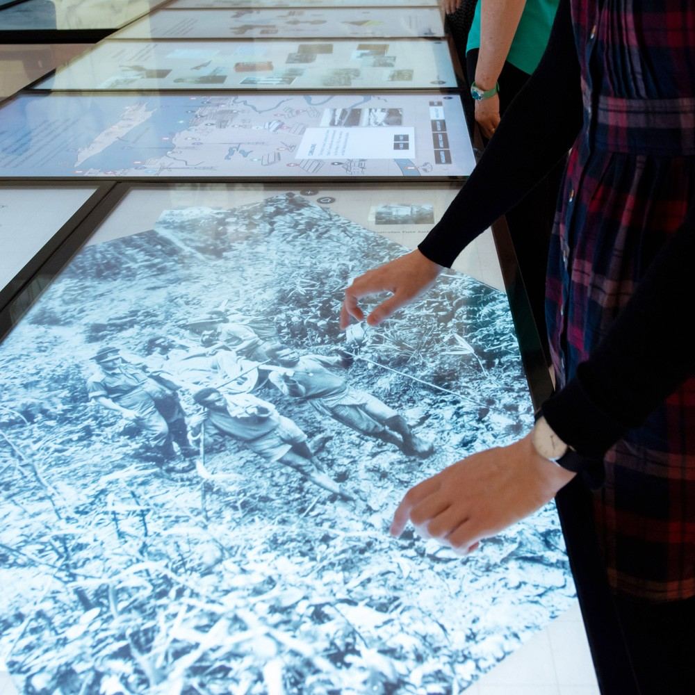 Woman using touch screen in World War II Gallery