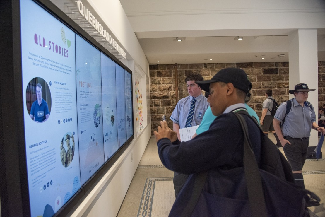 Students using touch wall in Memorial Galleries, Anzac Square