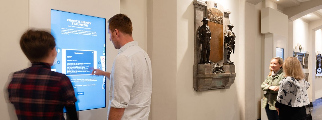 Man using touch screen in World War I gallery, Anzac Square